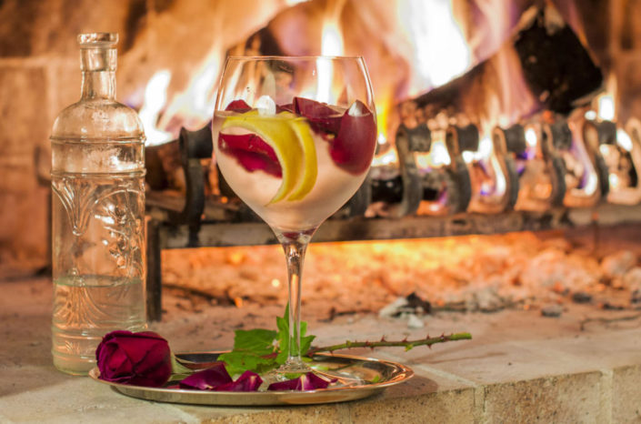 drink and roses by fireplace