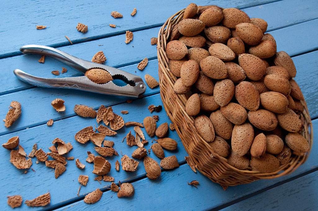 almonds with nut cracker